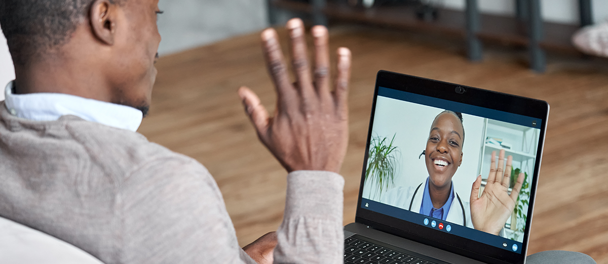 doctor and patient connecting via laptop through telehealth